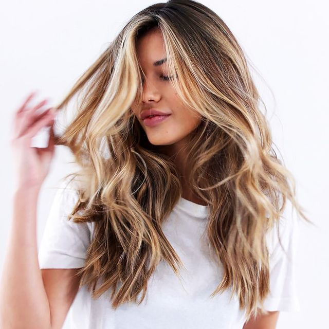 This is What Experts Put in Their Hair Before Using a Hot Tool